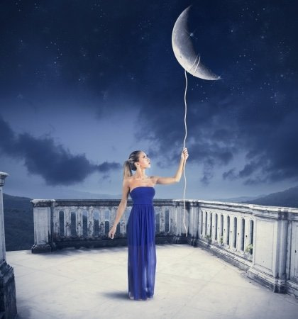 Girl holding a string attached to the moon