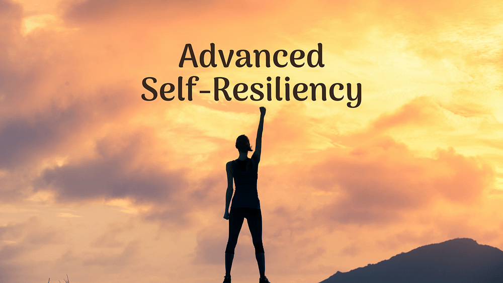 person with self-resiliency at the top of a mountain
